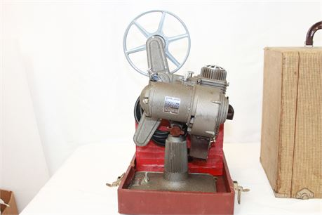 Vintage Revere Eight 8mm Film Projector W/ 4 8mm Home Movies