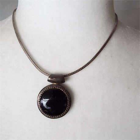 Sterling Silver Necklace With Black Center Stone also set In Sterling Silver