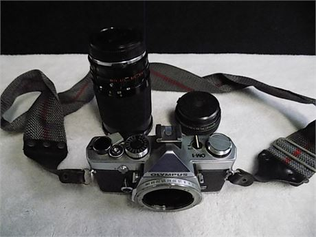 Olympus OM-1 SLR 35mm Film Camera with Olympus 50mm+35-200mm Lens