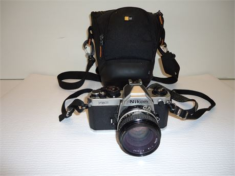 Nikon Camera Model# FM2 With Case Pre-Owned( Not Tested)